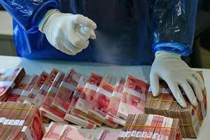 Дезинфекция денежных купюр